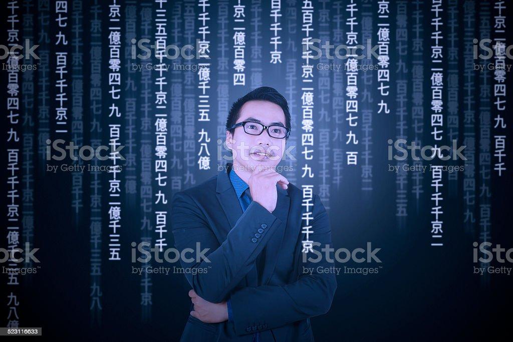 Thoughtful man translating information stock photo