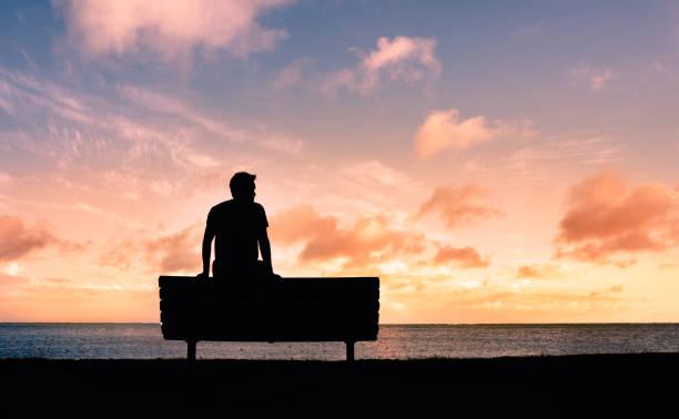Thoughtful man watching a sunset