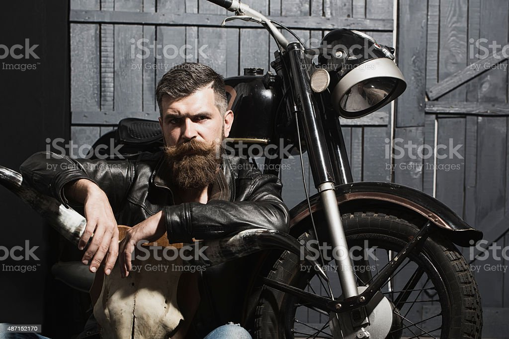 Thoughtful man with skull stock photo