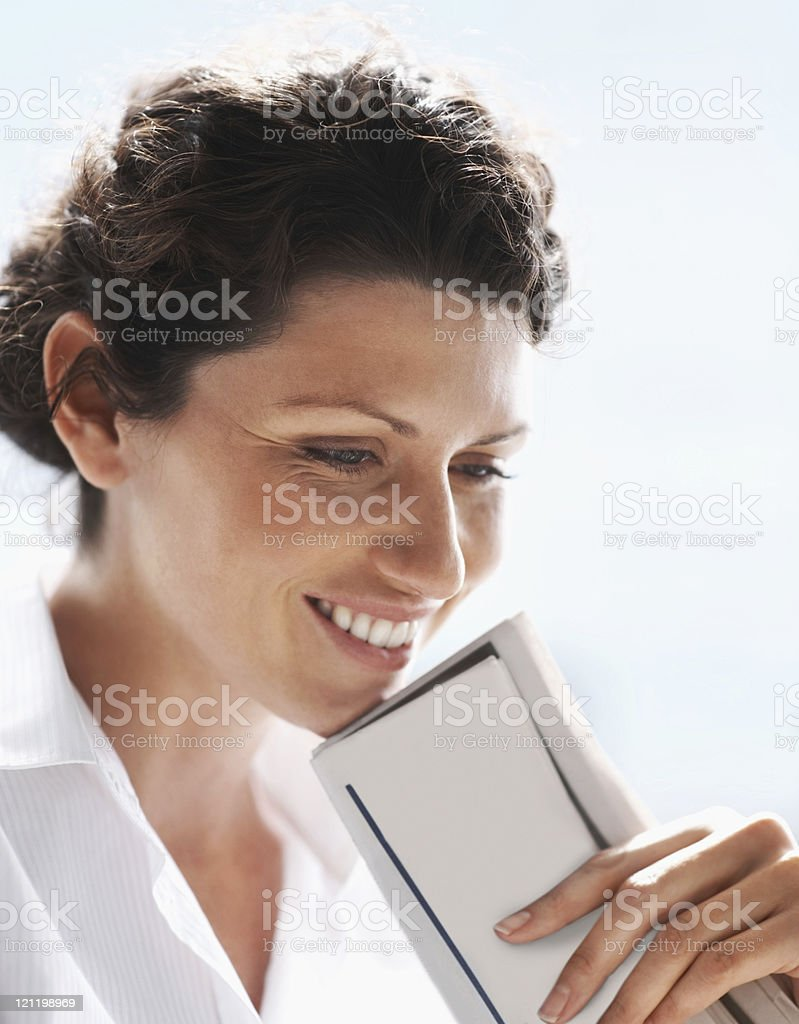 Thoughtful mature business woman  smiling against white royalty-free stock photo