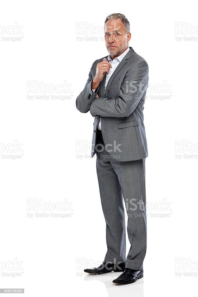 Thoughtful mature businessman stock photo