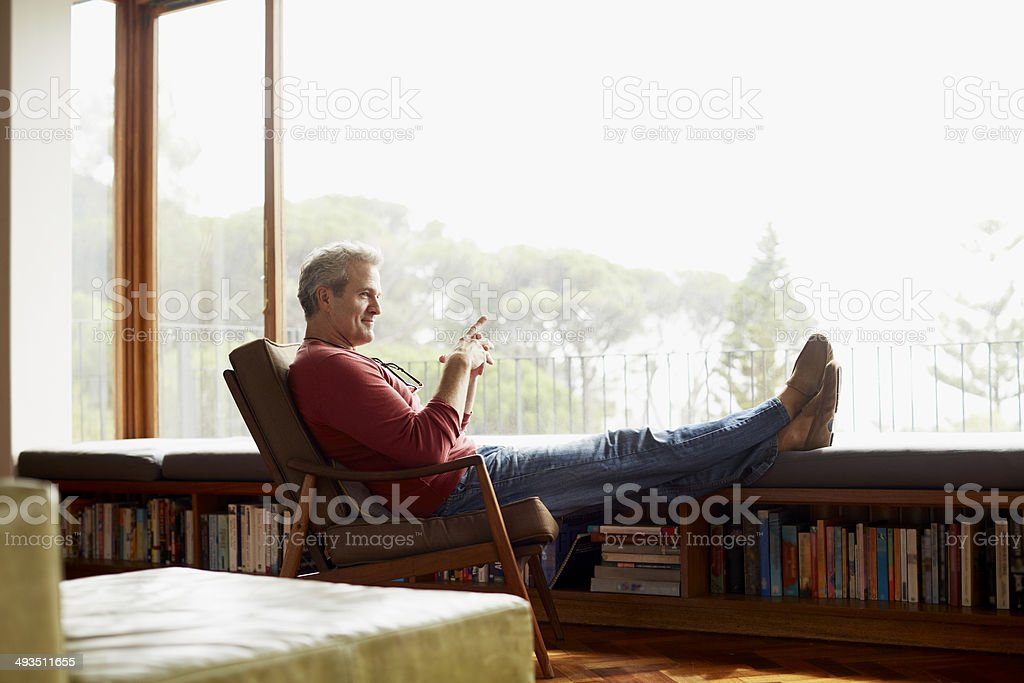 Thoughtful mature man relaxing on armchair – Foto