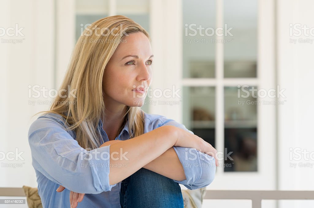 Thoughtful mature woman stock photo