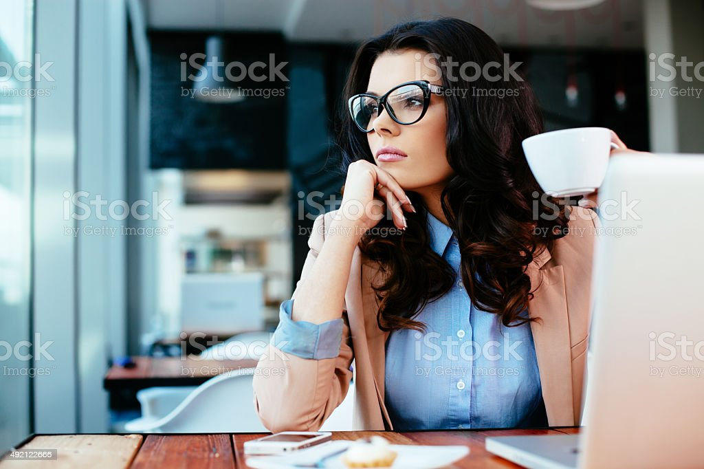 Thoughtful moment with a cup of coffee stock photo