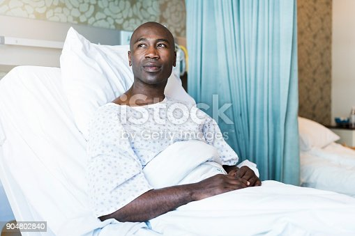 istock Thoughtful patient lying on bed in hospital 904802840