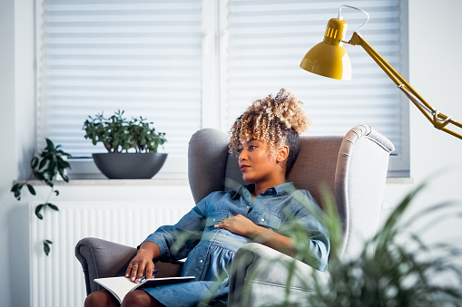 Thoughtful Pregnant Owner Resting In New Office Stock Photo - Download Image Now