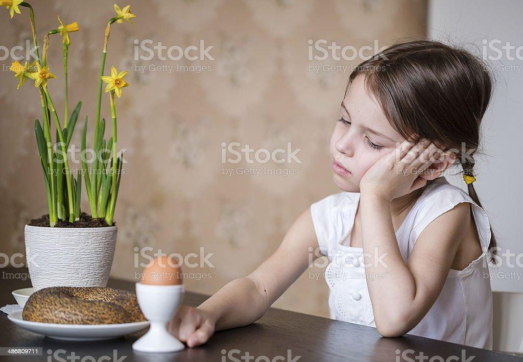 Thoughtful preschooler girl refusing to eat stock photo