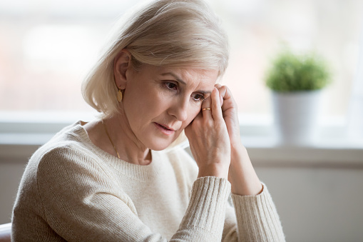 istock Thoughtful sad middle aged woman feeling blue thinking of anxiety 1049512636