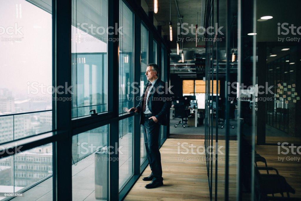 Thoughtful senior businessman stock photo