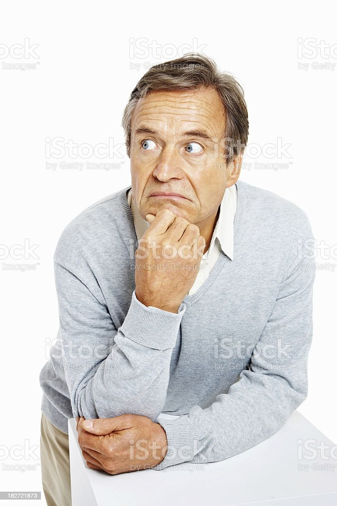 Thoughtful senior guy looking at copy space stock photo