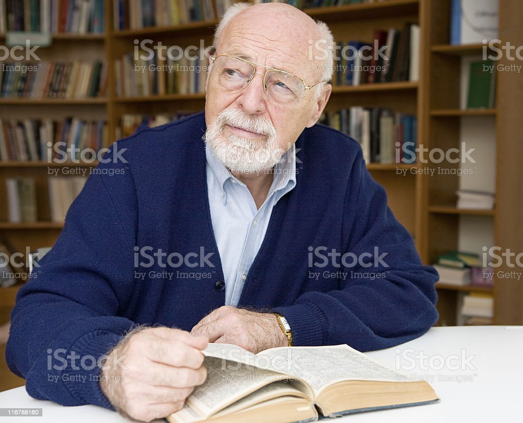 Thoughtful Senior in Library royalty-free stock photo