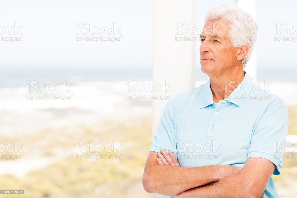 Thoughtful Senior Man With Arms Crossed royalty-free stock photo