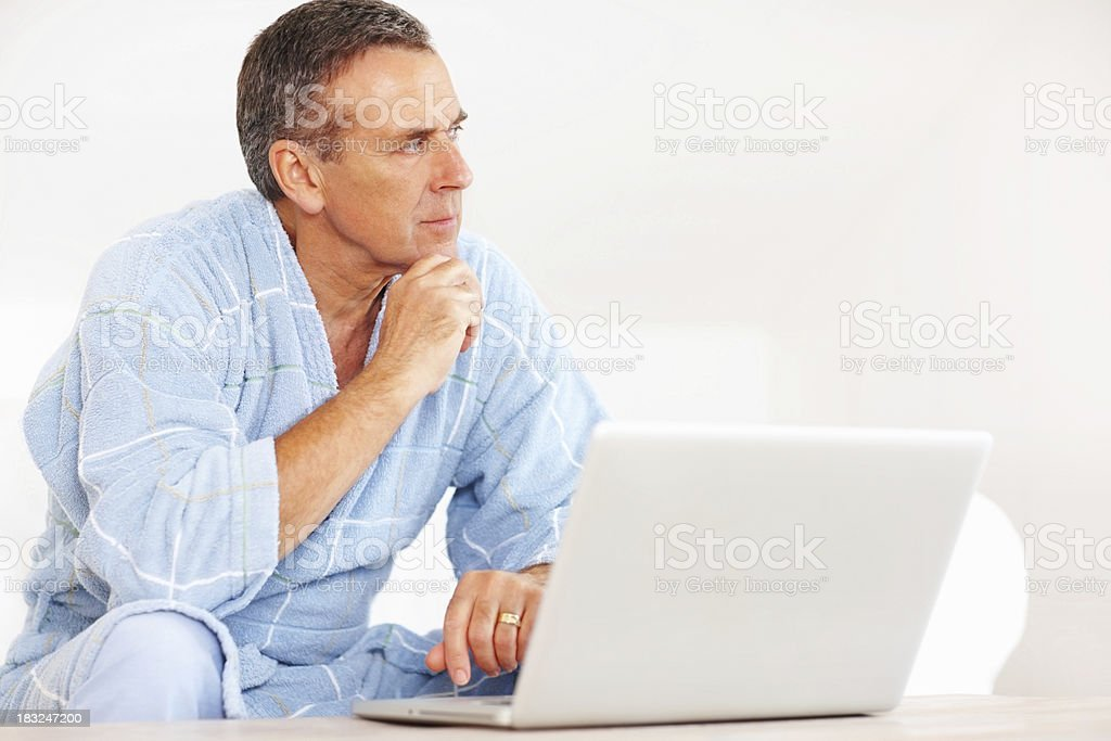 Thoughtful senior man  with laptop looking at - copyspace royalty-free stock photo