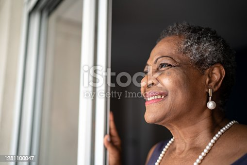 istock Thoughtful senior woman looking at view 1281100047