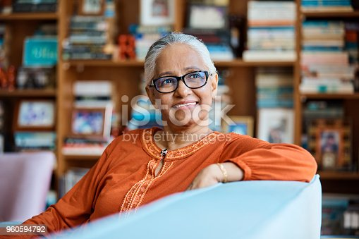 istock Thoughtful senior woman sitting on sofa at home 960594792