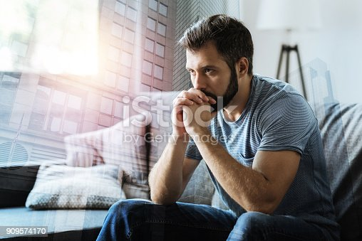 istock Thoughtful serious man sitting and thinking 909574170