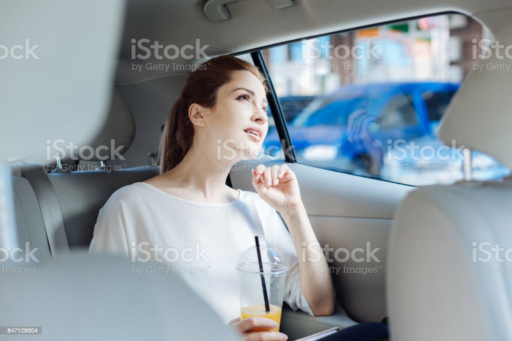 Thoughtful smart businesswoman going for work stock photo