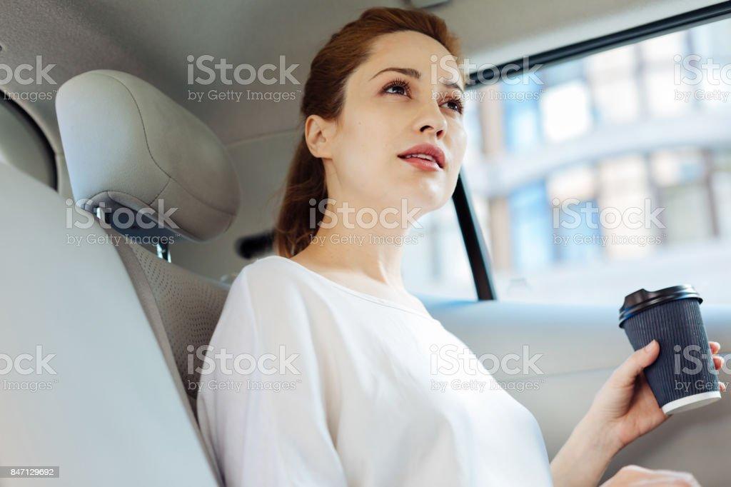 Thoughtful smart woman drinking coffee stock photo