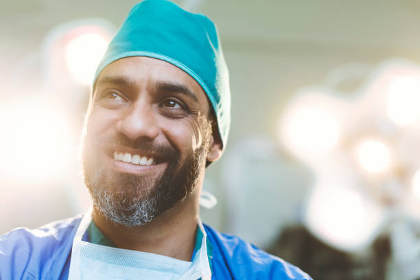 Thoughtful smiling doctor in hospital stock photo