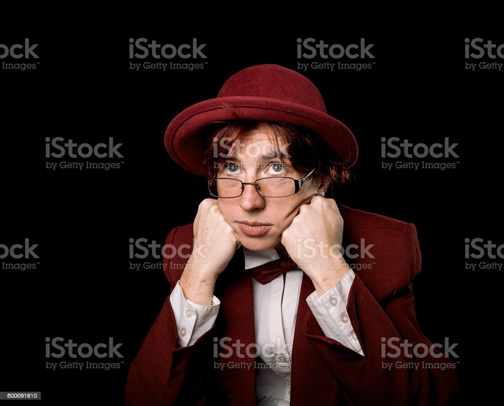 Thoughtful strange person in red stock photo