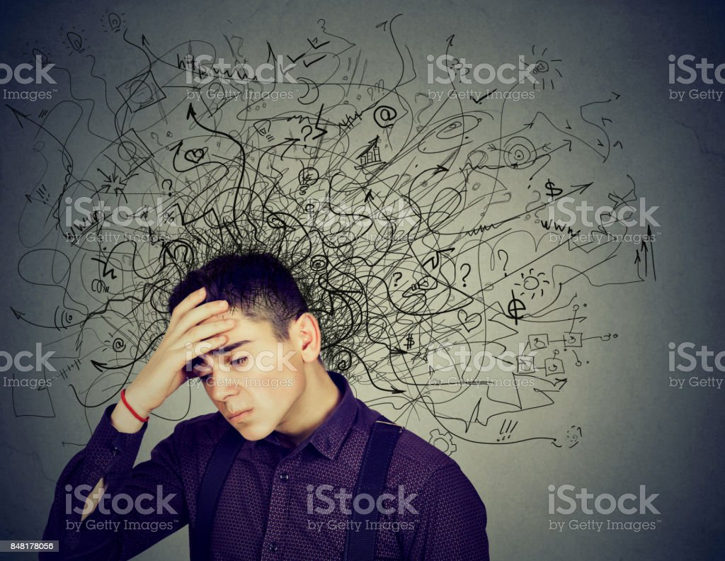 Thoughtful stressed man with a mess in his head stock photo