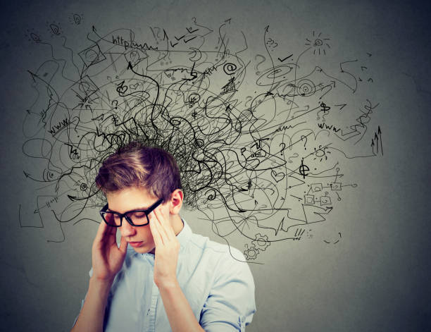 thoughtful stressed man with a mess in his head - mental health stock photos and pictures