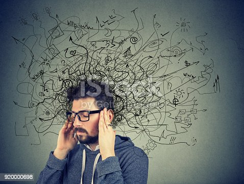 istock Thoughtful stressed man with a mess in his head 920000698