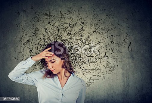 istock Thoughtful stressed woman with a mess in her head 982740530