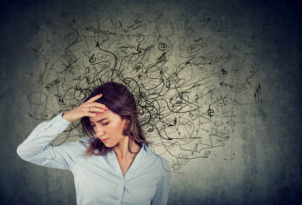 Thoughtful stressed woman with a mess in her head stock photo