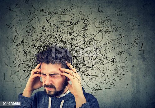 istock Thoughtful stressed young man with a mess in his head 924925656