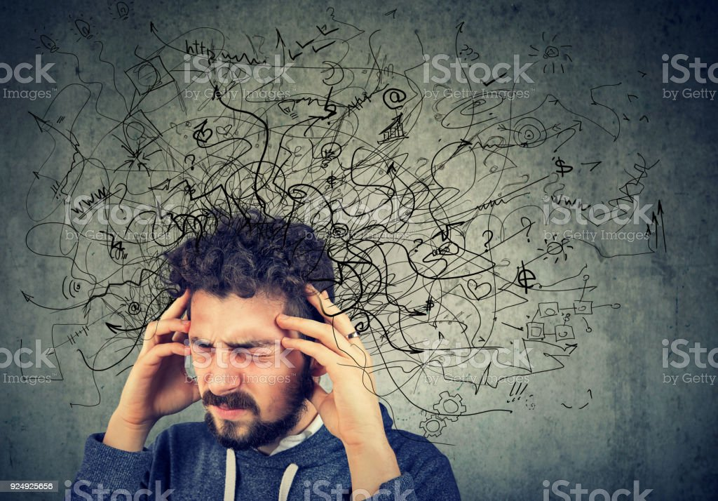 Thoughtful stressed young man with a mess in his head stock photo