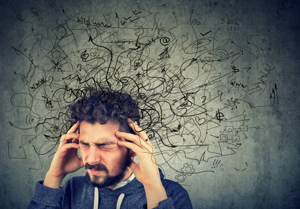 Thoughtful stressed young man with a mess in his head Thoughtful stressed young man with a mess in his head apprehension stock pictures, royalty-free photos & images