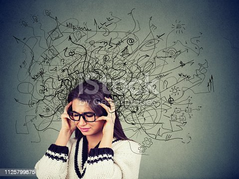 istock Thoughtful stressed young woman in glasses with a mess in her head 1125799875