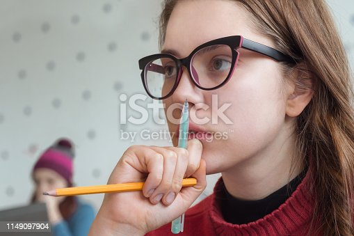 istock Thoughtful student at the university. Portrait of thinking female listening to lecturer, teacher, professor. Hipster girl learning, studying in creative atmosphere. Brain training. Smart girl portrait 1149097904