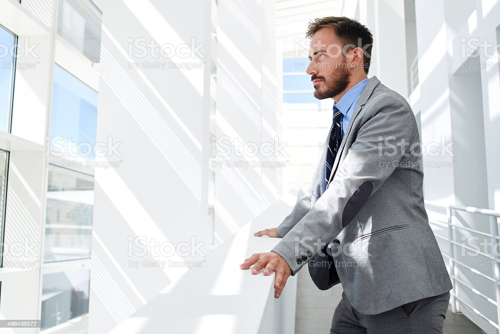 Thoughtful successful managing director resting after meeting with his partners stock photo