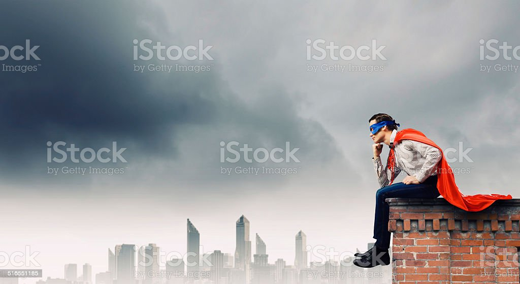 Thoughtful superman stock photo