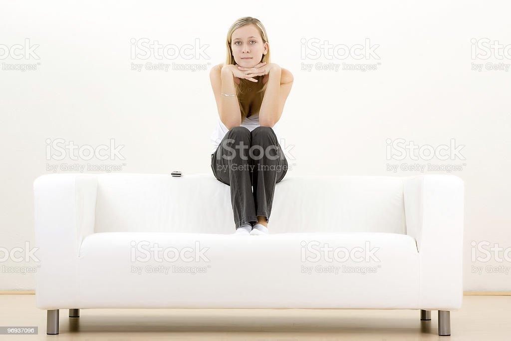 Thoughtful teenager on sofa royalty-free stock photo