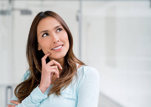 Thoughtful woman at a shopping center stock photo