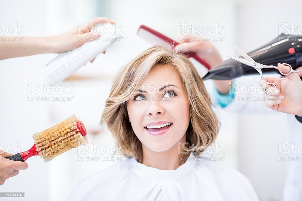 Thoughtful woman at the hair salon stock photo