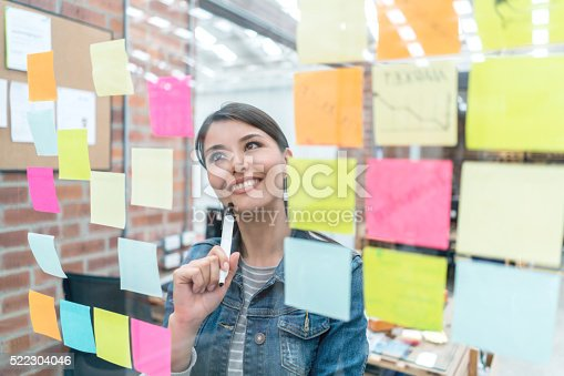 istock Thoughtful woman brainstorming at a creative office 522304046
