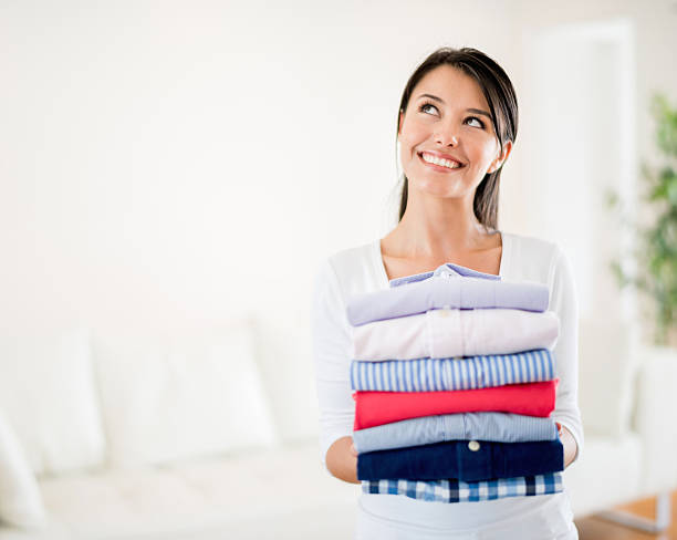 Thoughtful woman doing the laundry stock photo