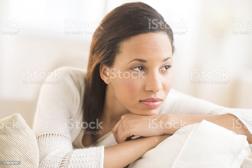 Thoughtful Woman Looking Away At Home royalty-free stock photo