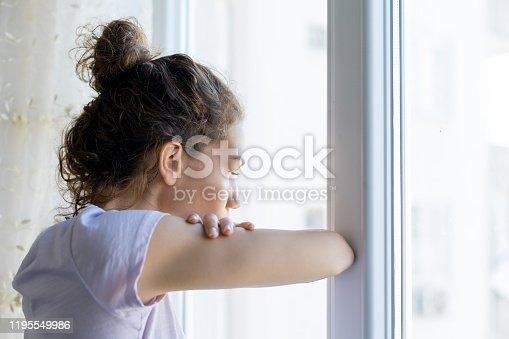 917874758 istock photo Thoughtful woman looking near window 1195549986