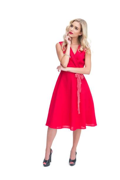 durchdachte frau posieren in roten kleid - wickelkleid lang stock-fotos und bilder