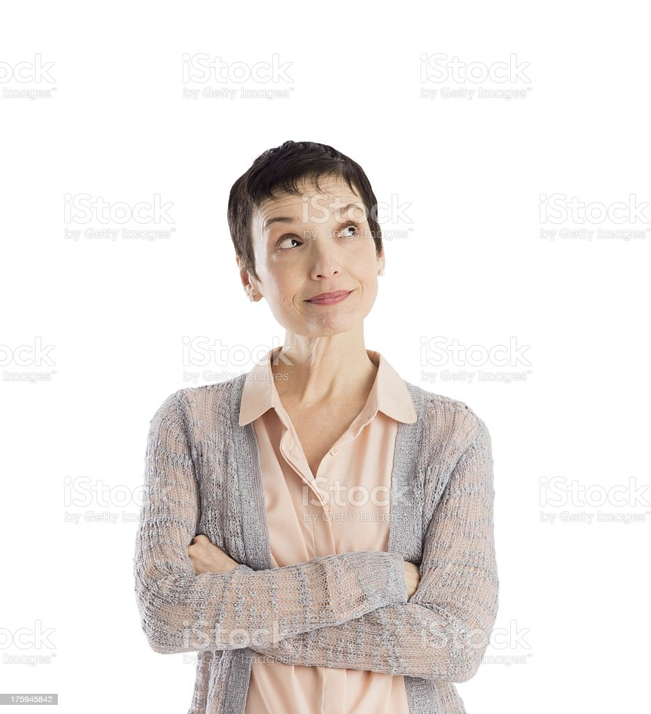 Thoughtful Woman With Arms Crossed Looking Up stock photo