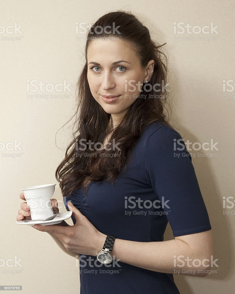 Thoughtful woman with cup of coffee royalty-free stock photo