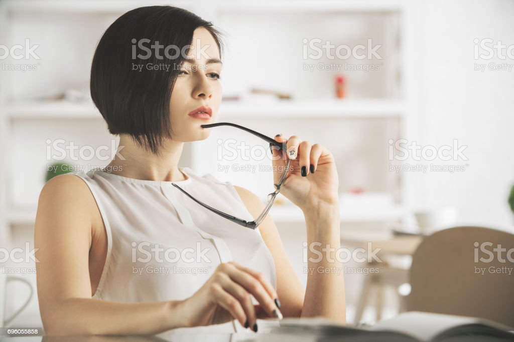 Thoughtful woman with spectacles stock photo