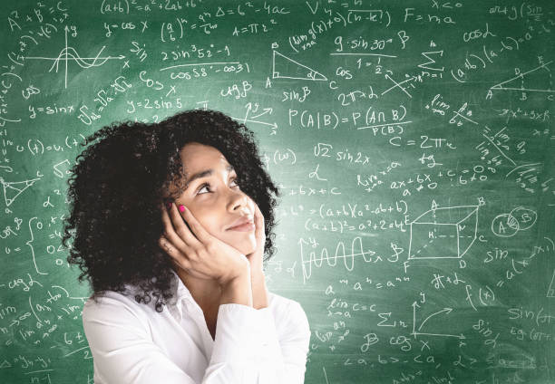 Thoughtful young African woman, math formula