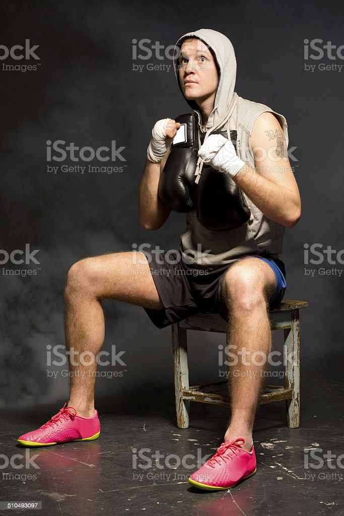Thoughtful young boxer waiting for a match stock photo