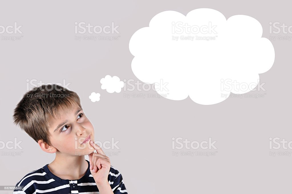 Thoughtful young boy stock photo